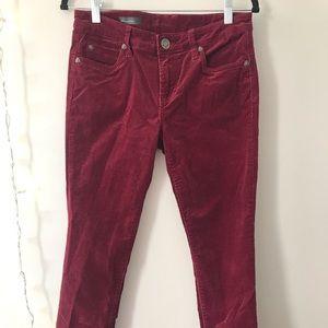 Corduroy maroon skinny jeans.